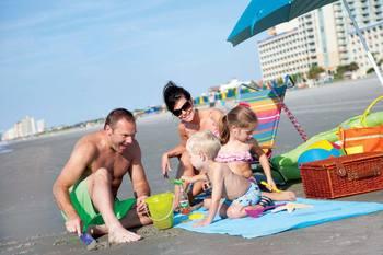 Family on beach at Paradise Resort.
