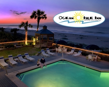 Outdoor pool with beach view at Ocean Isle Inn.