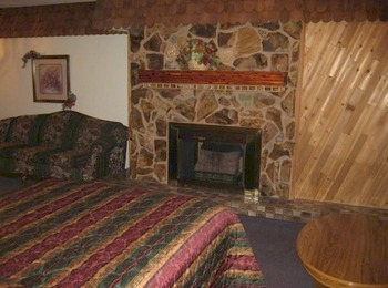 Fireplace guest room at Cedar Wood Inn.