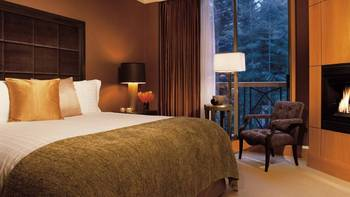 Guest bedroom at Four Seasons Resort Whistler.