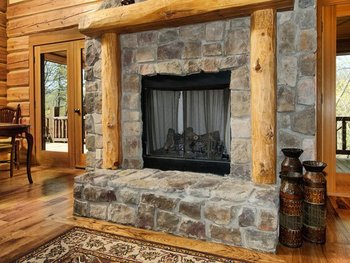 Cabin fireplace at Greybeard Rentals.