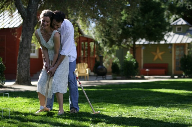 Couple playing croquet at Cottages Of Napa Valley.