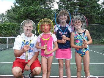 Kids playing tennis at Fair Hills Resort.
