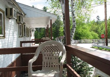 Private Porch at Riverbank Motel & Cabins