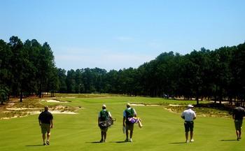 Playing golf at Pinehurst Resort.