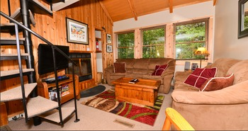 Cabin living area at Black Bear Resort Rentals.
