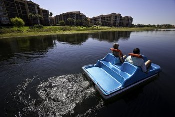 Couple On Paddle Boat at Westgate Lakes Resort