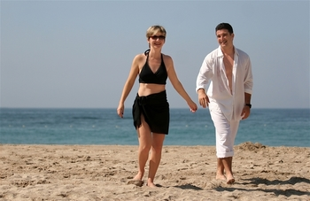 Couple on the beach at Sanctuary Realty At Sandbridge.