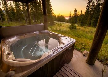 Rental hot tub at Black Diamond Vacation Rentals.
