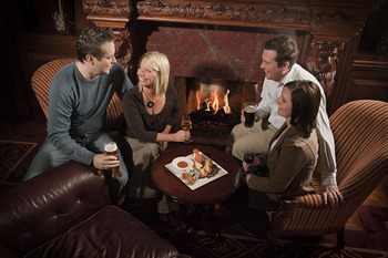 Couples By Fireplace at Prince of Wales Hotel