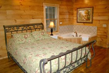 Whirlpool bedroom from As Good As It Gets cabin at New River Trail Cabins.