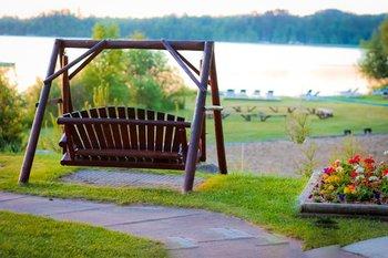 Swinging bench over lake at Thunder Lake Lodge.