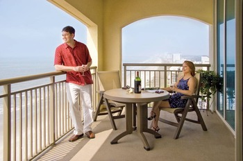 Couple on the balcony at Mar Vista Resort Grande.
