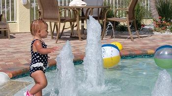 Kid in pool at Sunset Vistas.