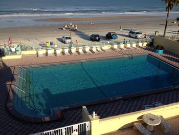 View of pool and beach at Fountain Beach Resort.