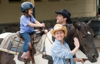 Family riding horses at  Rocking Horse Ranch