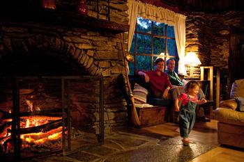 Family in cabin at Cataloochee Ranch.