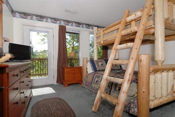 Cabin bedroom at Fireside Chalets & Cabin Rentals.