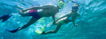 Couple snorkeling at Palm Island Resort.