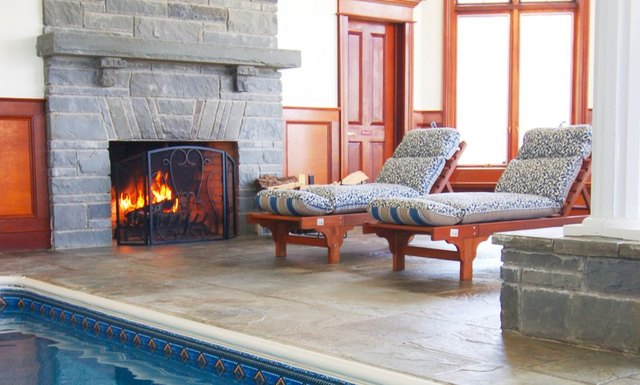 Fireplace by the pool at B & B Ranch.