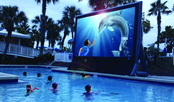 Watching A Movie In The Pool at TradeWinds Island Grand
