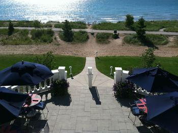 Patio by the water at Blue Harbor Resort & Spa.