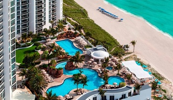 Outdoor pool and beach at Trump International Beach Resort.