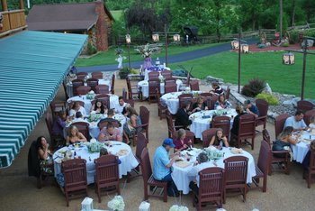 Outdoor wedding dining at Smoke Hole Caverns & Log Cabin Resort.