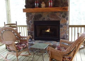 Fireplace porch at Nevaeh Cabins.