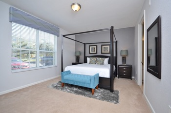 Rental bedroom at Orlando Luxury Escapes Vacation Rentals.