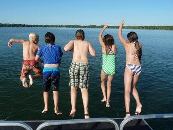 Jumping into the lake at Woodlawn Resort.