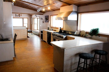 Saranac Suite kitchen at Ampersand Bay Resort.  Great for family reunions and gatherings.