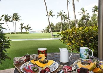 Dining on balcony at Maui Vacation Rentals.