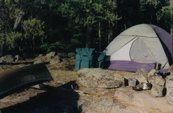 Camp along the lake shore at  Lodge of Whispering Pines.
