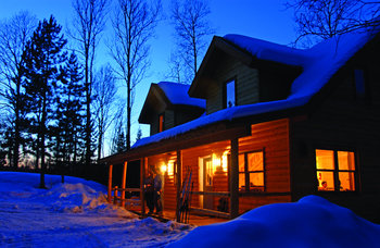 Snow-covered Cabin at Timber Trail Lodge & Resort