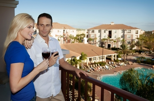 Couple On Balcony at Vista Cay Resort
