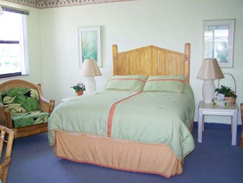 Vacation rental bedroom at Gulf Winds Resort Condominiums.