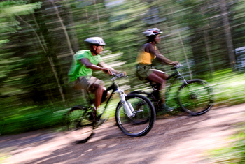 Biking at The Woods At Bear Creek Glamping Resort.