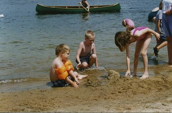 Kids playing on the beach at All-Season Cottage Rentals.