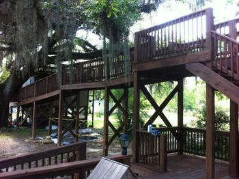 Raised deck to tree house at Berry Creek, LLC.
