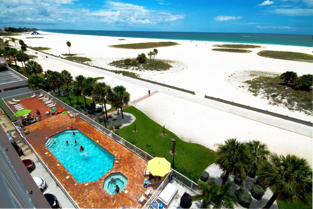 Beach and pool view at Sunsational Beach Rentals. LLC.