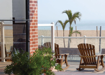 Rocking chairs on the porch at Plim Plaza Hotel Ocean City.