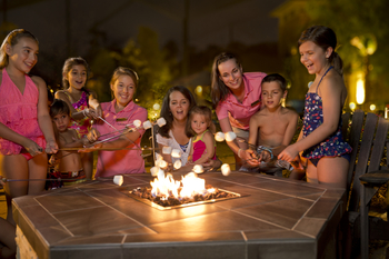 Family by fire pit at The Woodlands Resort and Conference Center.