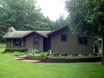 Rental exterior at Sand County Service Company - Majestic Timber Retreat.