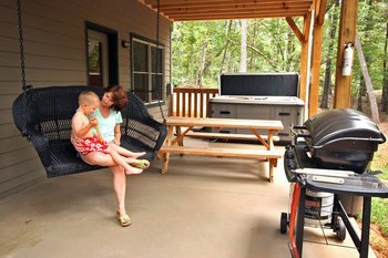 Family on porch at Sautee Resorts.