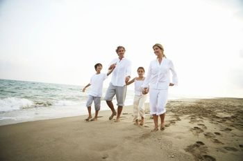 Family on beach at Litchfield Real Estate.