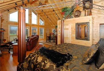 Honeymoon cabin bed at Golden Anchor Cabins.