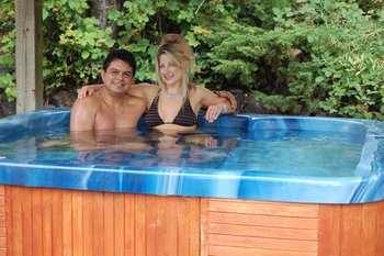 Couple In Hot Tub at  Hood Canal Cottages