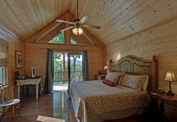 Cabin bedroom at Mountain Top Cabin Rentals.