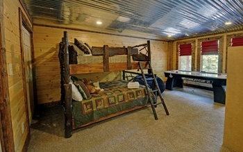 Cabin bedroom at Southern Comfort Cabin Rentals.